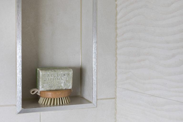 Bathroom eleven - close up of recessed shelf