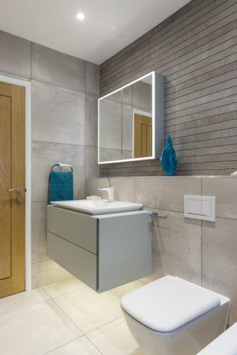 Family bathroom in warm grey in Surbiton