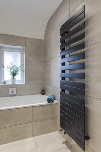 Zehnder black finish towel rail in Surbiton Bathroom