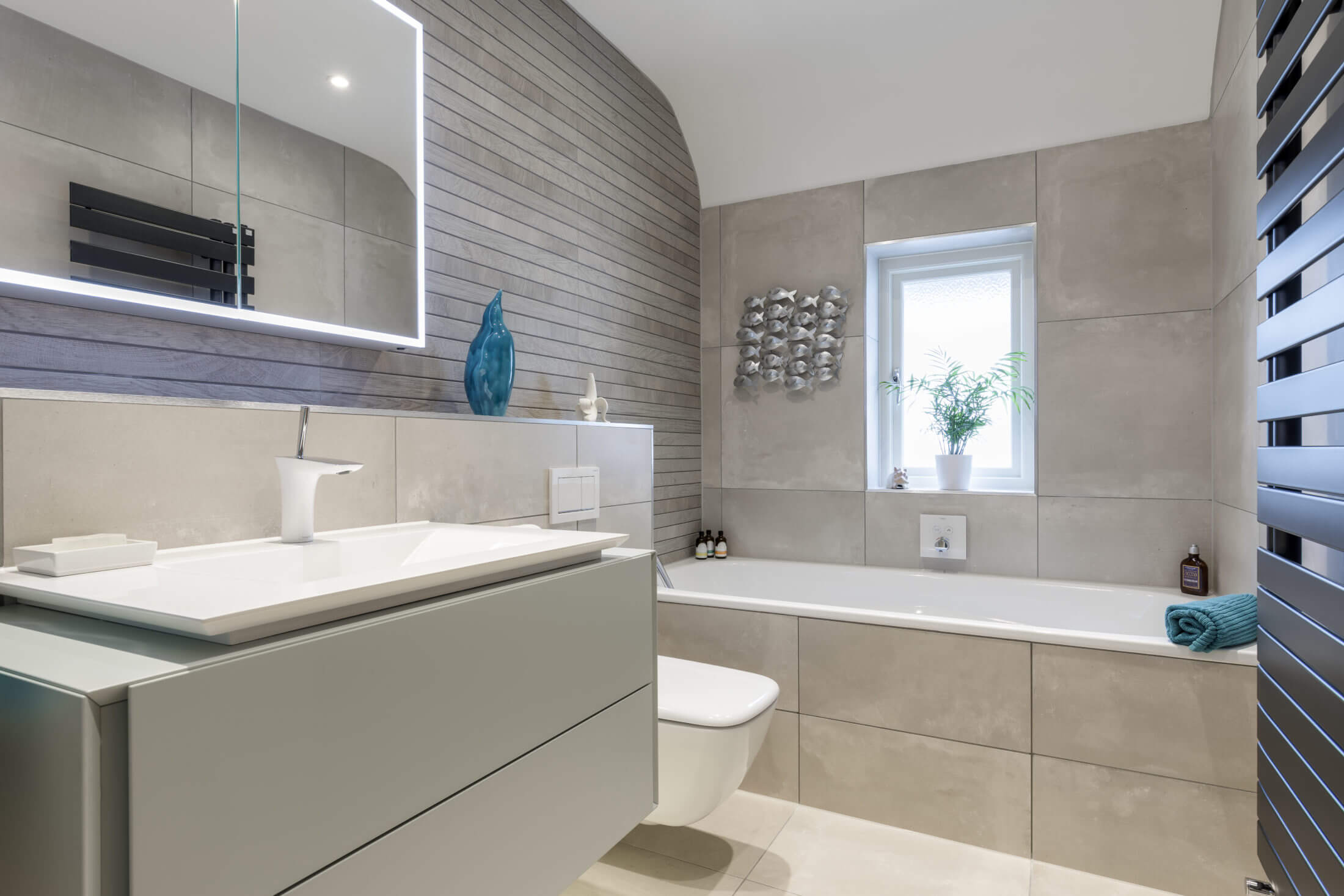Family bathroom in warm grey in Claygate