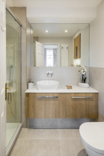 Spa style Ensuite with wavy tiles and modern basin units.