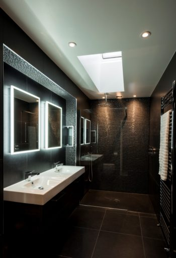 black tiled wetroom with double basin