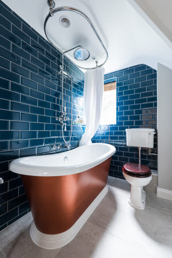Electric blue bathroom in Weybridge