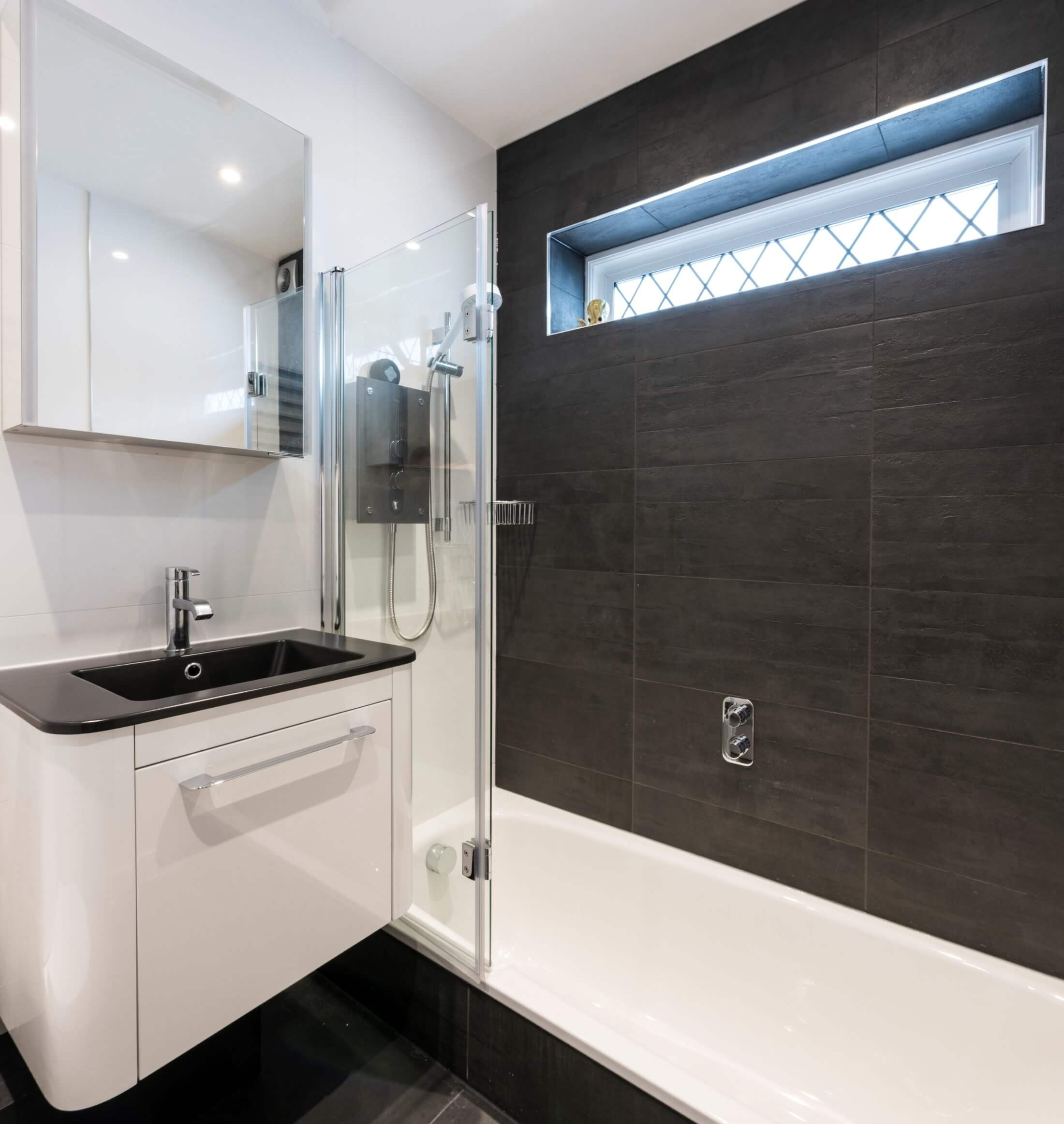 balck and white bathroom in Ashtead