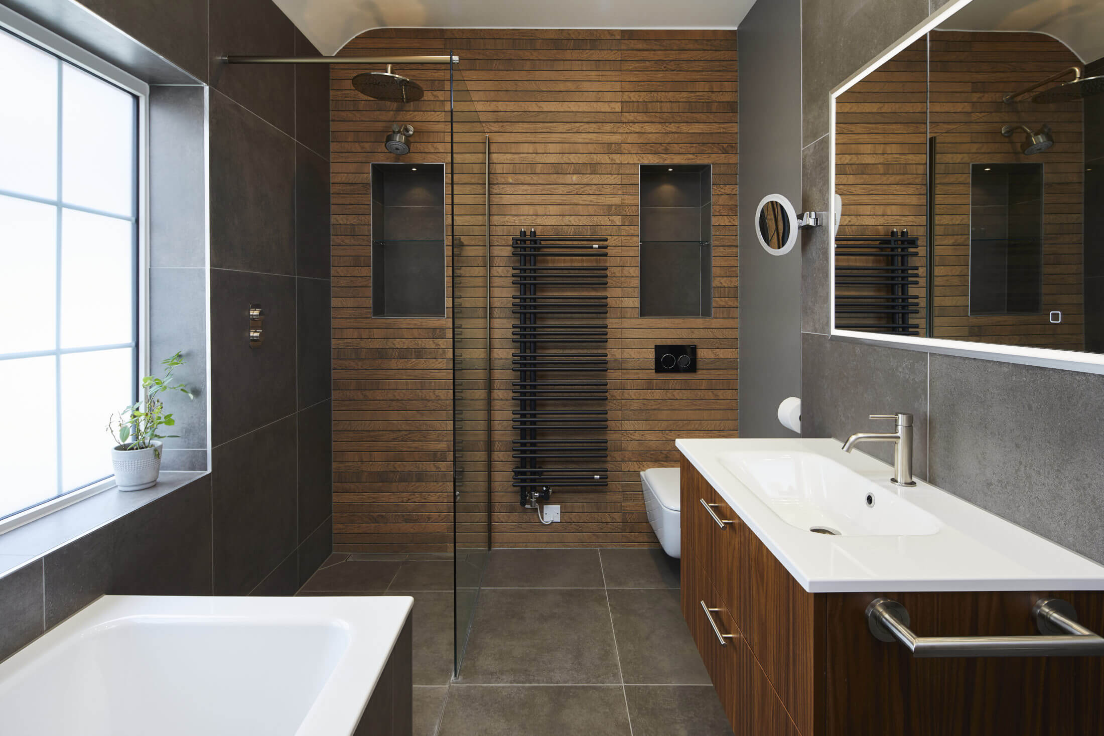 Bathroom with wetroom and bath in Teddington